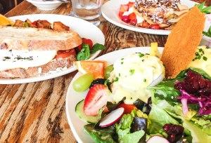 tess: crab + shrimp benedict adam: breakfast sandwhich kevin: pancakes